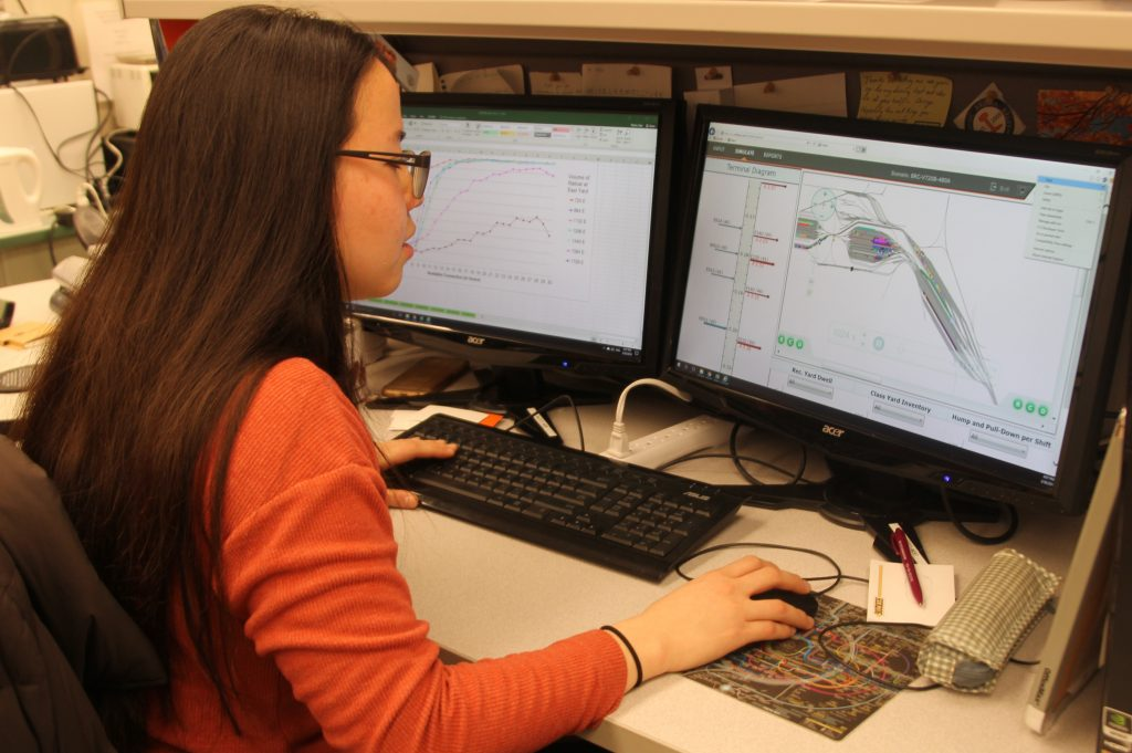 female railway engineering student viewing a railway simulation system